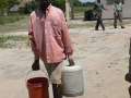 Young Man Geting Water